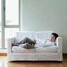 Side profile of a young man sleeping on a couch (thumbnail)