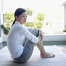 Side profile of a young woman sitting on the floor (thumbnail)