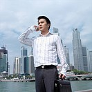 Low angle view of a businessman talking on a mobile phone (thumbnail)
