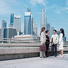 Businessman talking to three businesswomen