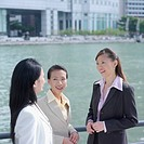 High angle view of three businesswomen smiling at each other
