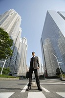 Businessman amid office buildings