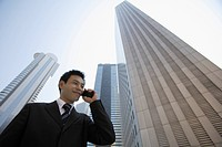 Businessman conversing on a cellphone (thumbnail)