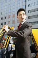 Man is stepping out of car, portrait