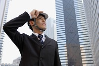 Businessman holding his hard hat, portrait (thumbnail)