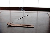 Close_up of an incense stick on a stand