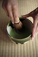 View of a person grinding with a pestle (thumbnail)