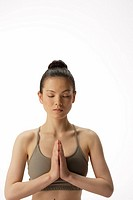 Close_up of a young woman meditating