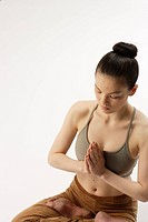 High angle view of a young woman in lotus position (thumbnail)