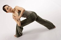 View of a young woman stretching her body (thumbnail)
