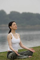 Front view of a woman in lotus position