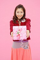 Portrait of a teenage girl holding a gift box (thumbnail)