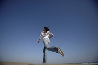 Low angle view of a young woman running