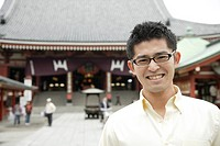 A young man standing outside temple (thumbnail)