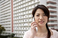 Portrait of a young woman using mobile phone