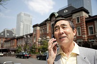View of a businessman using cellphone