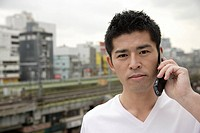 A young man using cellphone (thumbnail)