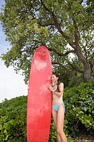 A woman holding surfboard