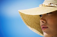 Close_up of a woman wearing hat