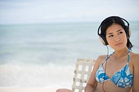 A woman listening music at beach