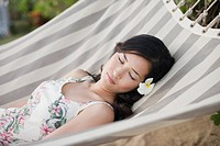 A woman sleeping on hammock (thumbnail)