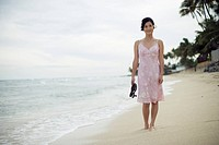 A young woman standing on beach (thumbnail)
