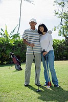 View of a couple with golf club