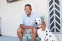 Mature man with dog (thumbnail)