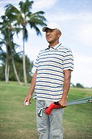 Mature man standing on golf course