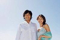 Low angle view of a young couple smiling (thumbnail)