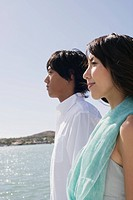 Profile of a young couple standing together