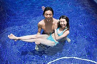 Elevated view of a couple in swimming pool