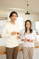 Father and daughter 14_15 with tea cup, portrait
