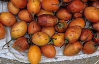 Tamarillo Cyphomandra betacea fruit, on market stall, Otovalo, Ecuador