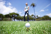 A golf ball placed on grass