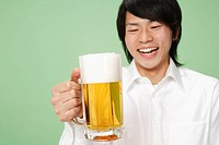 Young man holding stein of beer