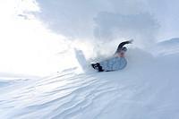 Young man snowboarding, Reutte, Tyrol, Austria
