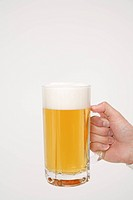 Human hand holding beer stein, close_up