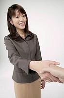 Young woman doing handshake