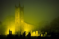 Thurch of St. John the Baptist and a graveyard in a foggy night, Bushmills, County Antrim, Ireland, Europe