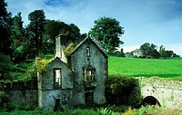 Decayed house in front of green meadow in the sunlight, County Kerry, Ireland, Europe