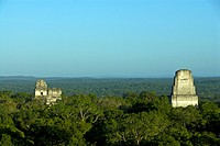 Mayan ancient ruined city and lowland tropical forest, Temples one, two and three, Tikal N P , Peten, Guatemala