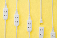 Extension cords plugged into extension socket, close_up