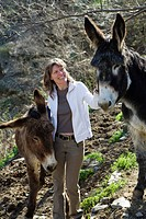 woman with donkeys in the Cevennes mountains, France