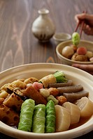 Oden with Saki set on table, close_up