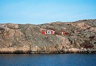 A red cottage on rocks.