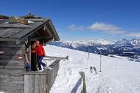 Woman entering alpine hut, Grosser Gabler, Valle Isarco, Dolomites, Trentino_Alto Adige/Suedtirol, Italy