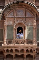 India _ Man sitting in window _ Apartments _ Metherangarh Fort, Jodhpur