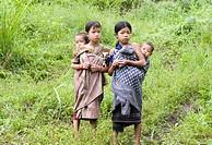 Mishmi girls, looking after younger siblings, Recon Village, Delei Valley, Mishmi Hills, Arunachal Pradesh, Northeast India