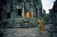 Buddhist monks, taking photograph in tower, Bayon, Angkor Thom, Angkor, Cambodia